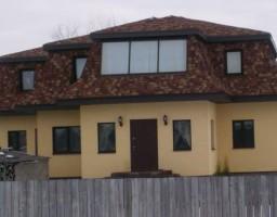 Алюминиевые окна в крыше загородного дома
